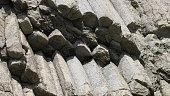 Rocks of Stolbchatiy cape in Kunashir, Kuril islands Russia