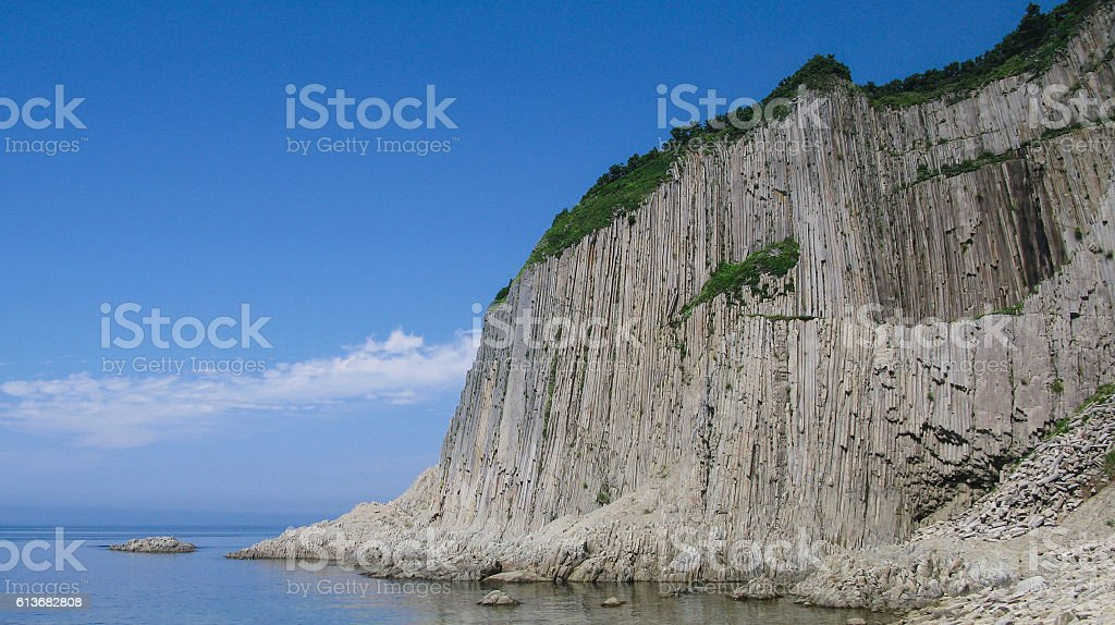 Rocks of Stolbchaty cape in Kunashir, kuril islands stock photo