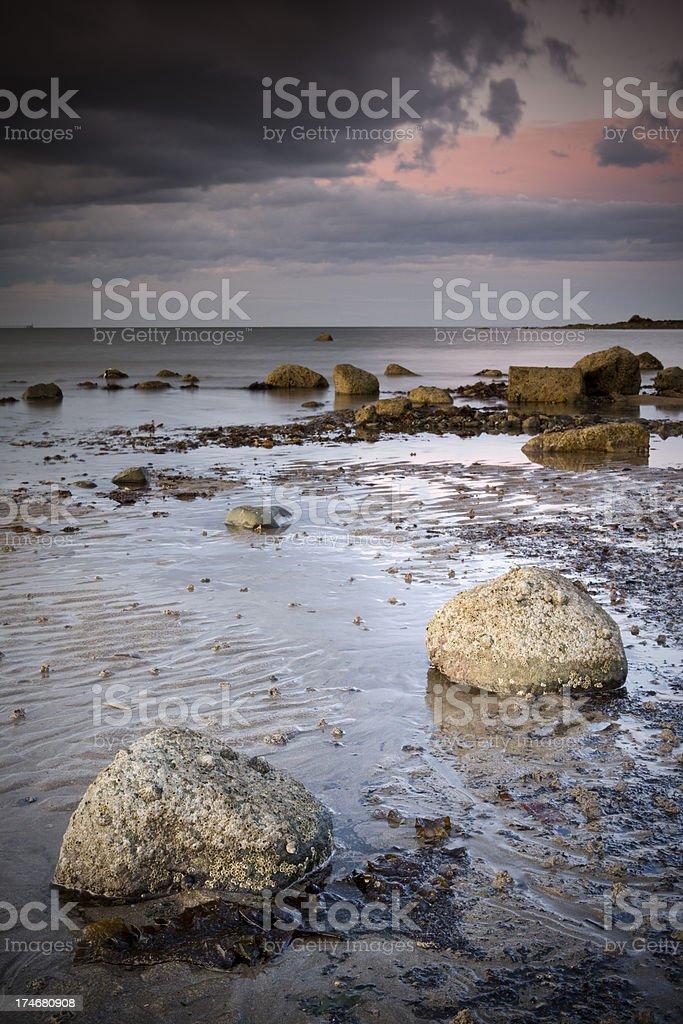 Rocks on beach in Ireland stock photo