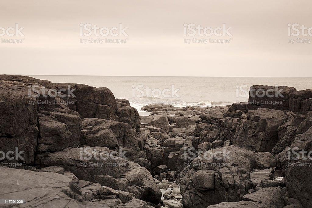 Rocks on Northumberland beach royalty-free stock photo