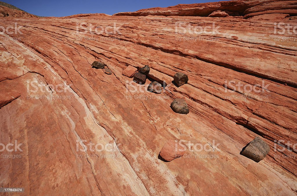Rocks on Striped Sandstone Near the Fire Wave royalty-free stock photo