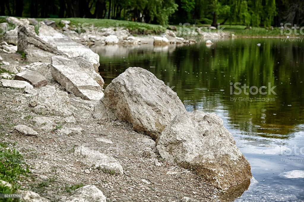 rocks on the lake side stock photo