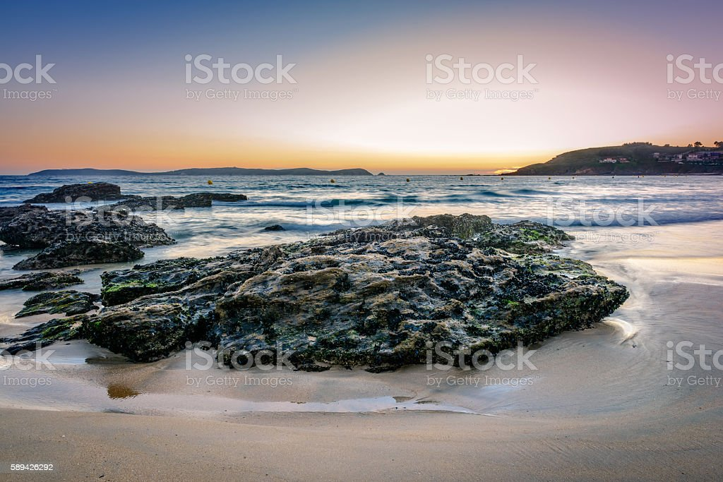 Rocks on the sand in the Rias Baixas, Galicia stock photo