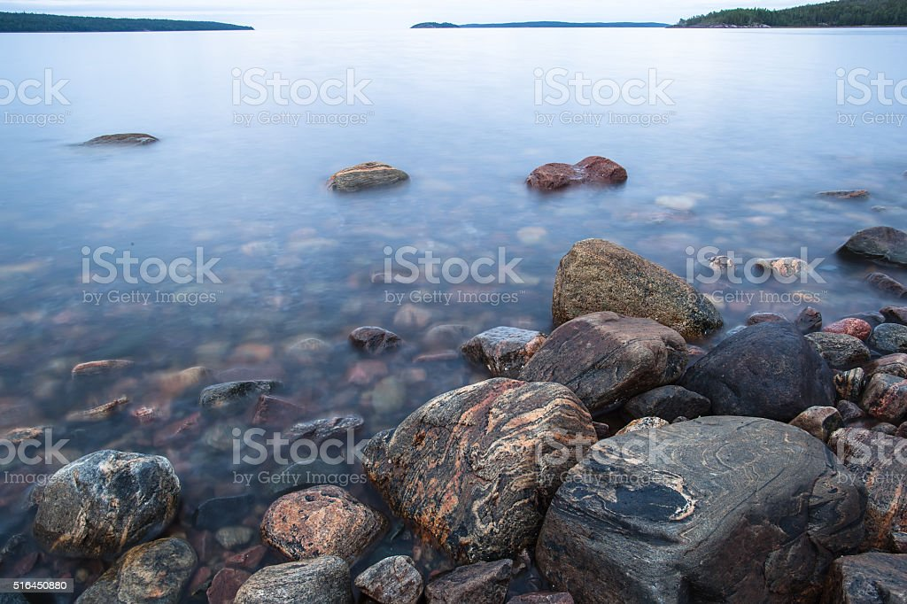 rocks on the shore of the White Sea stock photo