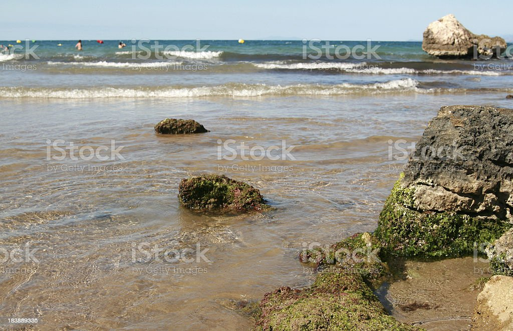 Rocks on the water, beach. royalty-free stock photo