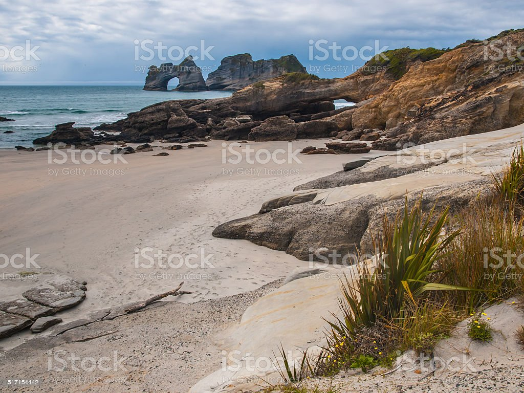 Rocks on Wharariki Beach stock photo
