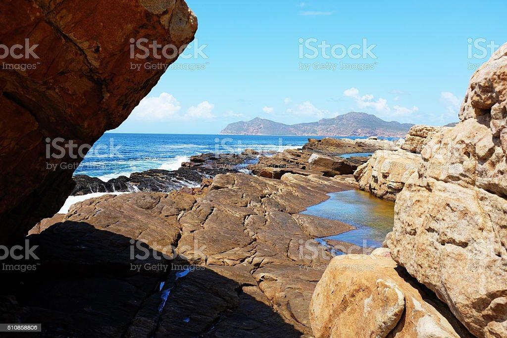 Rocks, sea and sky near Cape Point, South Africa stock photo