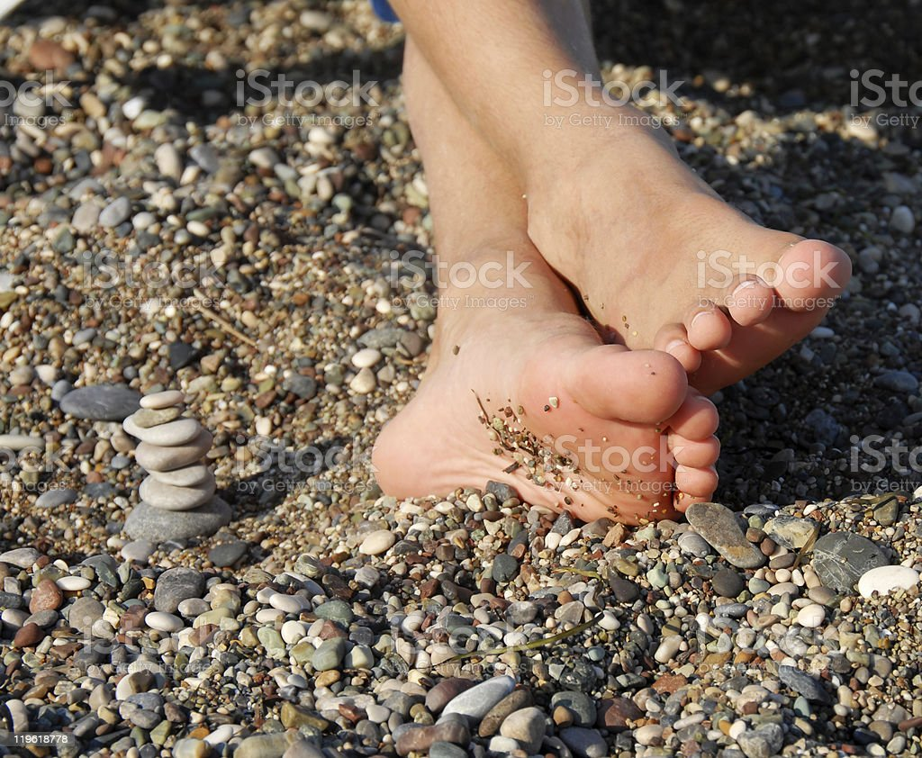 Rocks stack and boy feet royalty-free stock photo