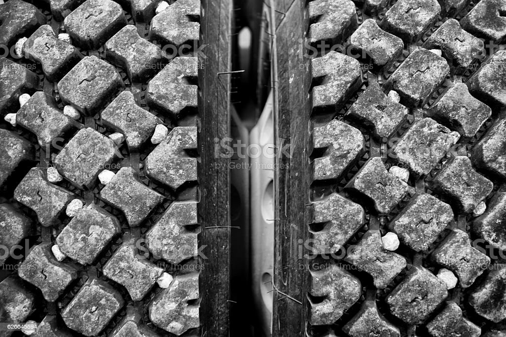 Rocks stuck in tire treads stock photo