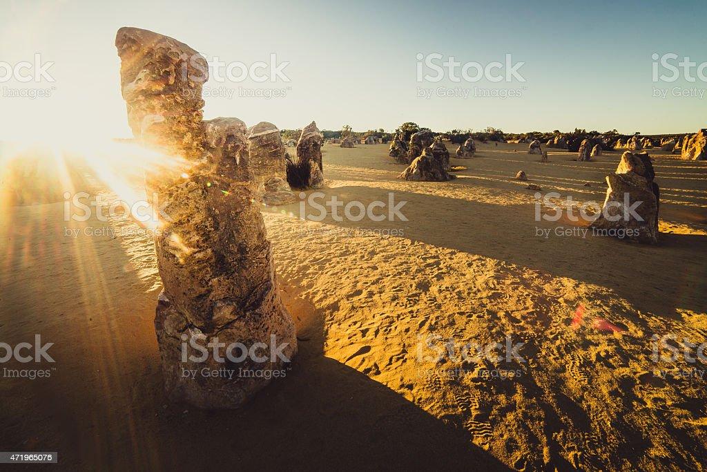 Rocks under sunrise stock photo