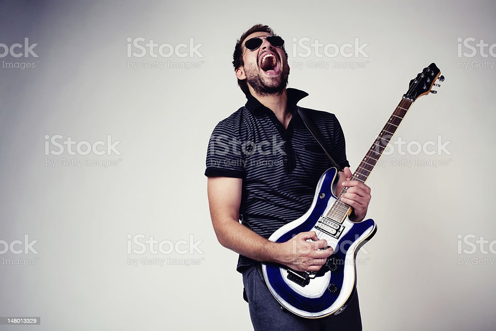 Rockstar guitar player stock photo