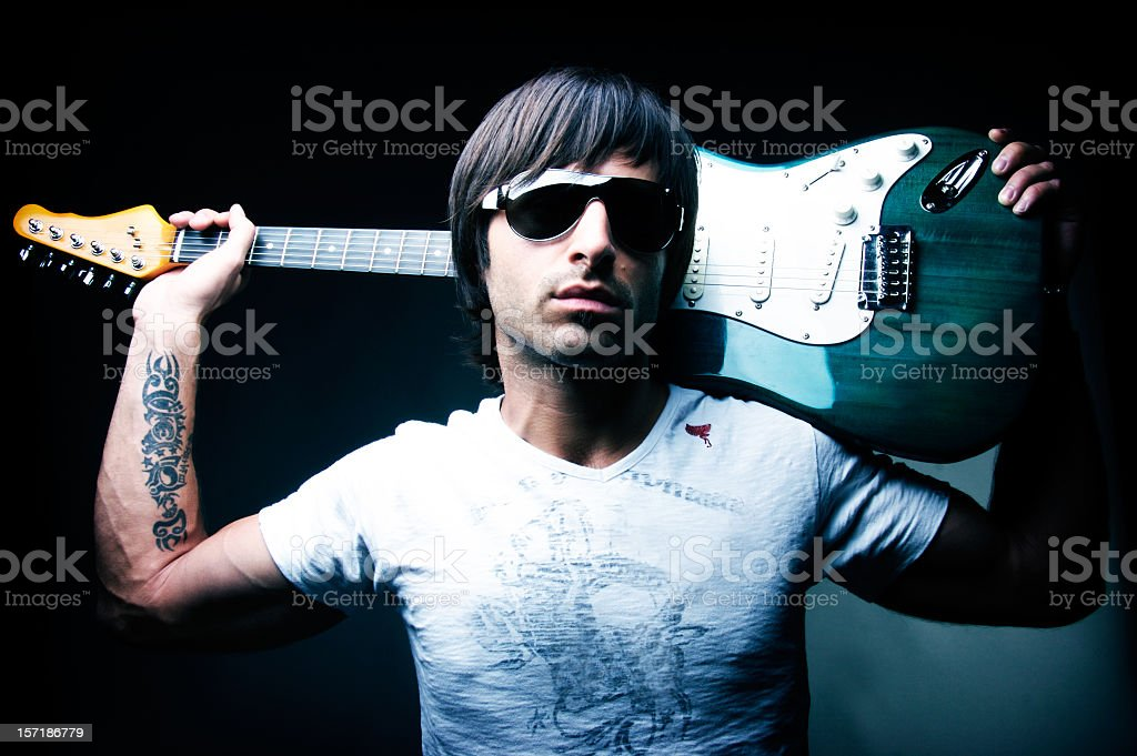 rockstar holding a guitar stock photo
