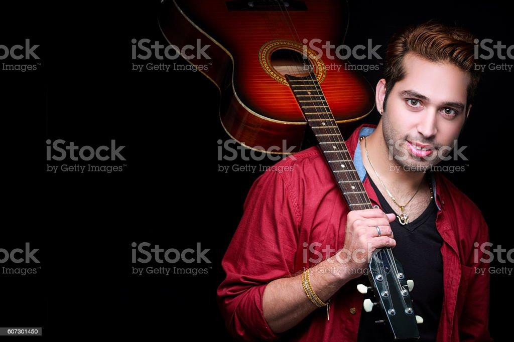 rockstar holding a guitar stock photo