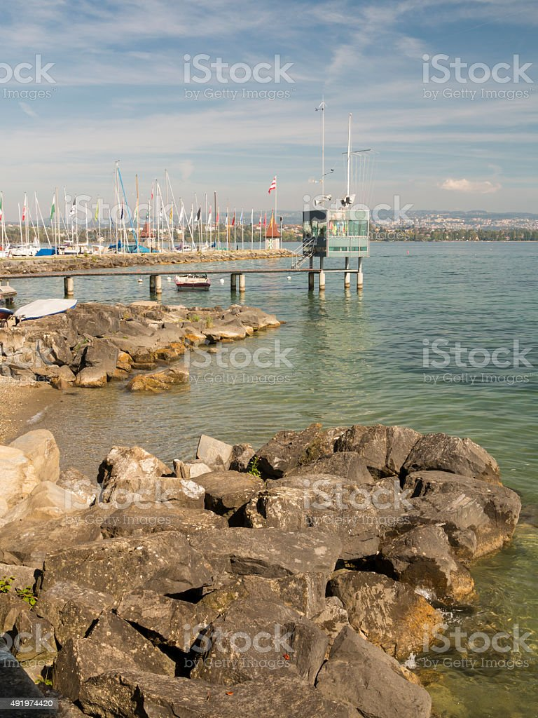 Rocky beach and pier at Veytaux on Geneva lake stock photo