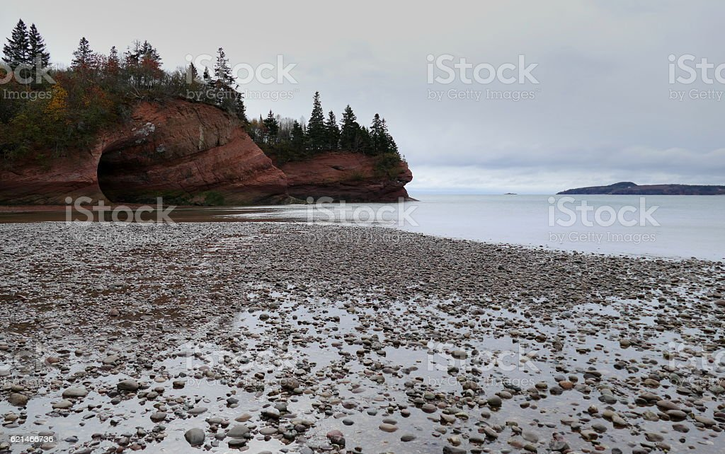 Rocky Beach and Sea Cave stock photo