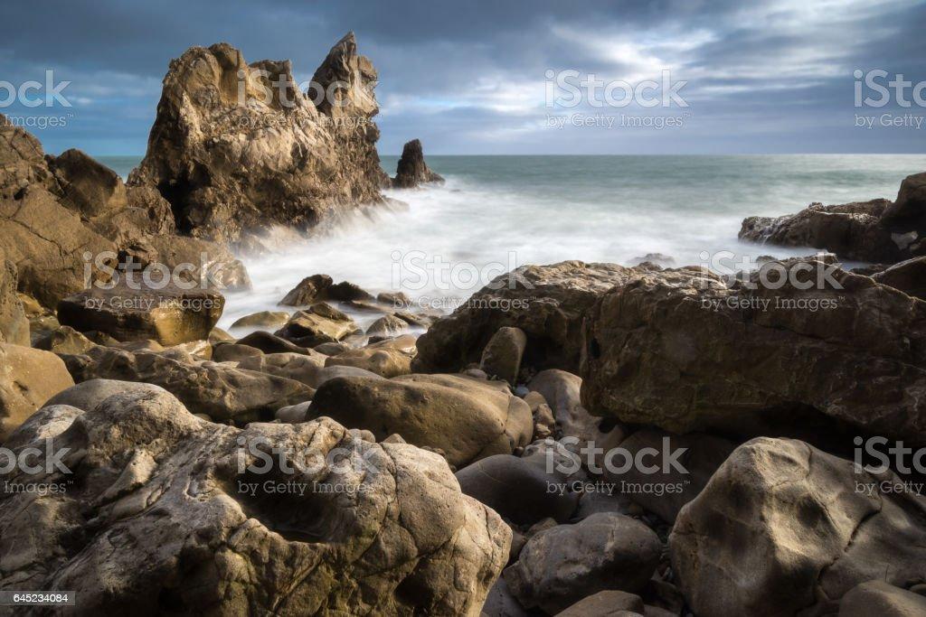 Rocky beach and waves at Corona del Mar, CA stock photo