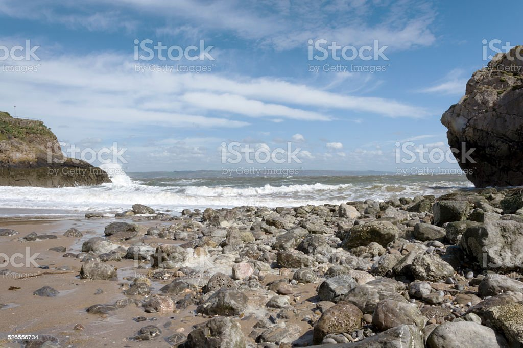 Rocky beach at low tide Tenby Pembrokeshire UK stock photo