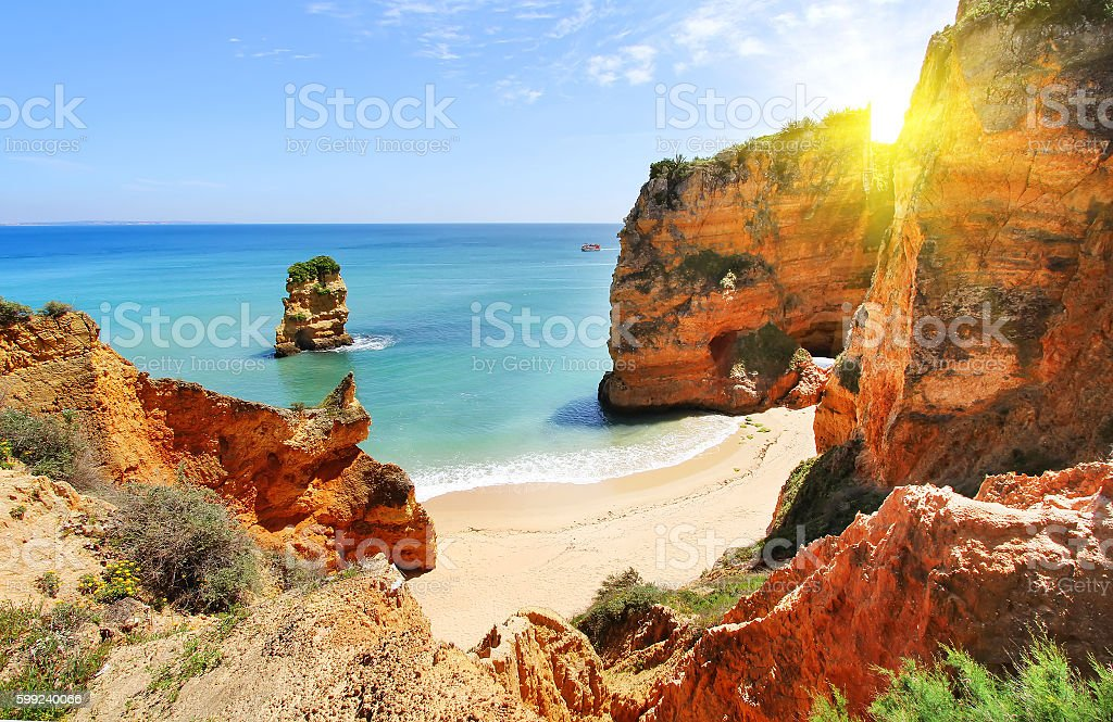 Rocky beach at sunset, Lagos, Portugal stock photo