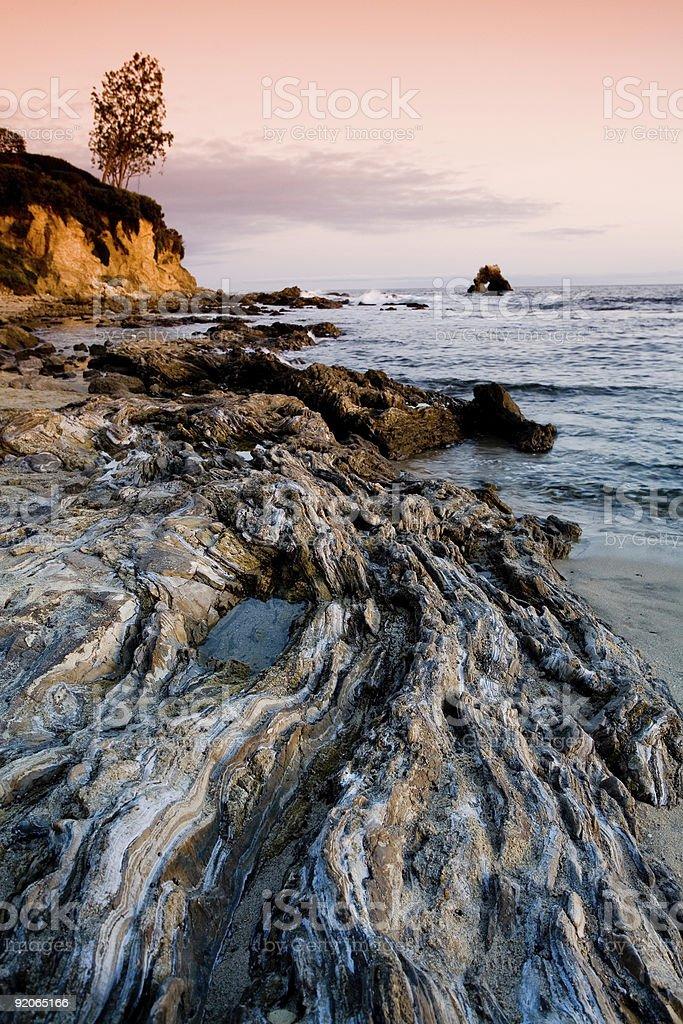 Rocky beach at sunset royalty-free stock photo