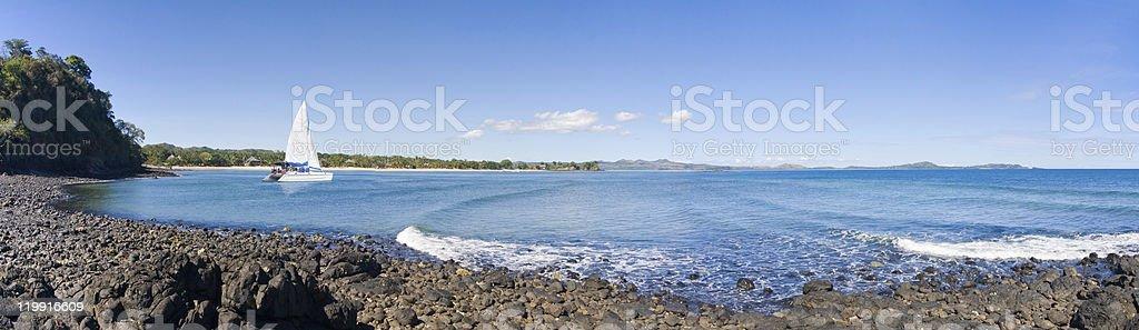 Rocky beach catamaran royalty-free stock photo