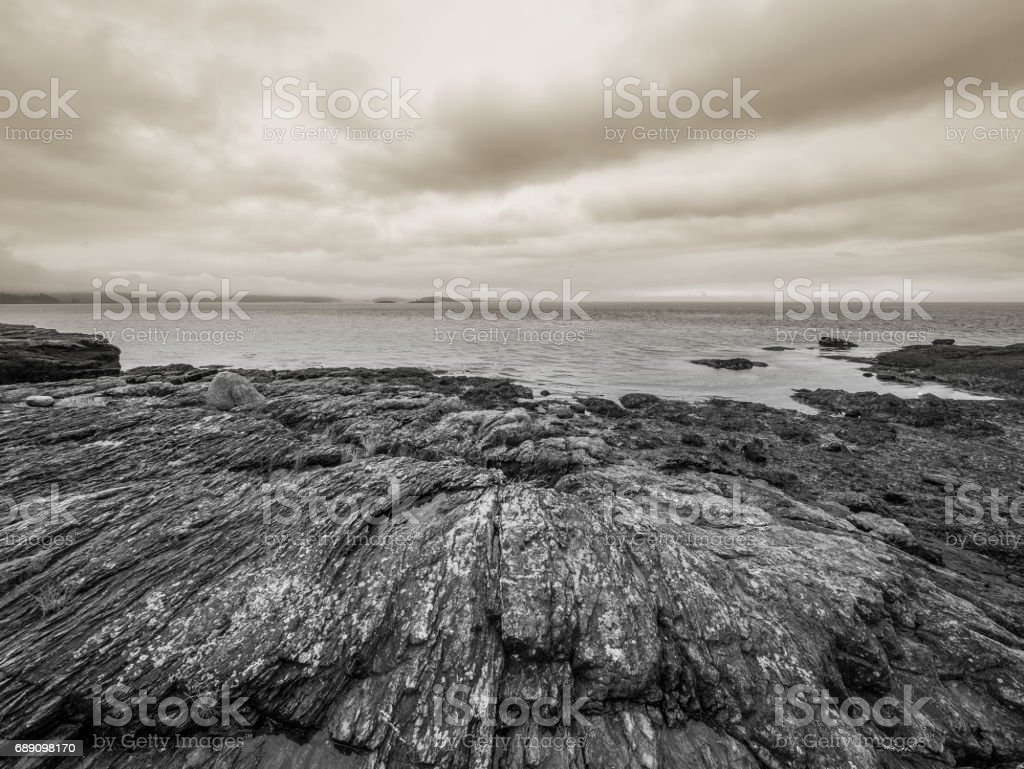 Rocky beach, Cattle Point Lighthouse trail. stock photo