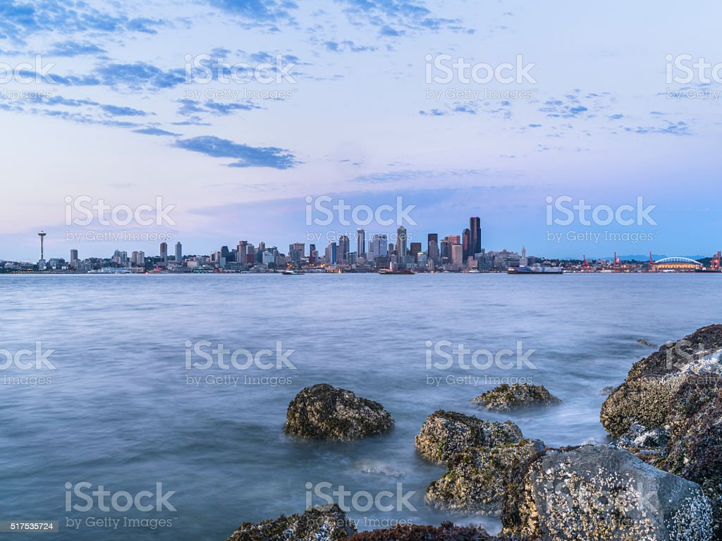 rocky beach in sunset, puget sound, alki beach, Seattle, usa stock photo