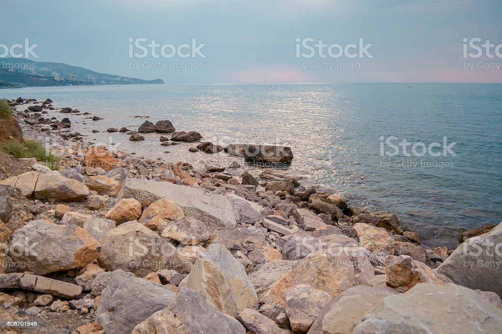 rocky beach on a cloudy day stock photo