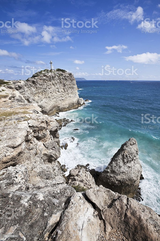 Rocky Caribbean Coast with Cross  in Guadeloupe royalty-free stock photo