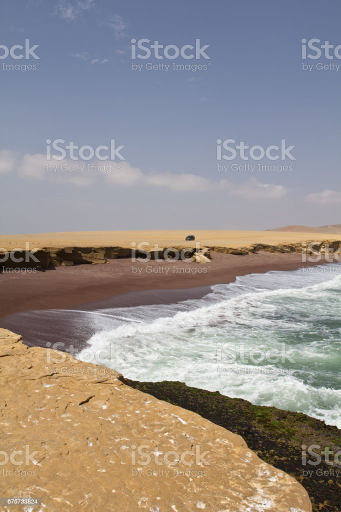 Rocky cliff and ocean with surf. Perfect place to see tropical desert, wide cliffs and coloful beaches on the rocky islands and national reserve. Small islands near the town of Paracas. stock photo
