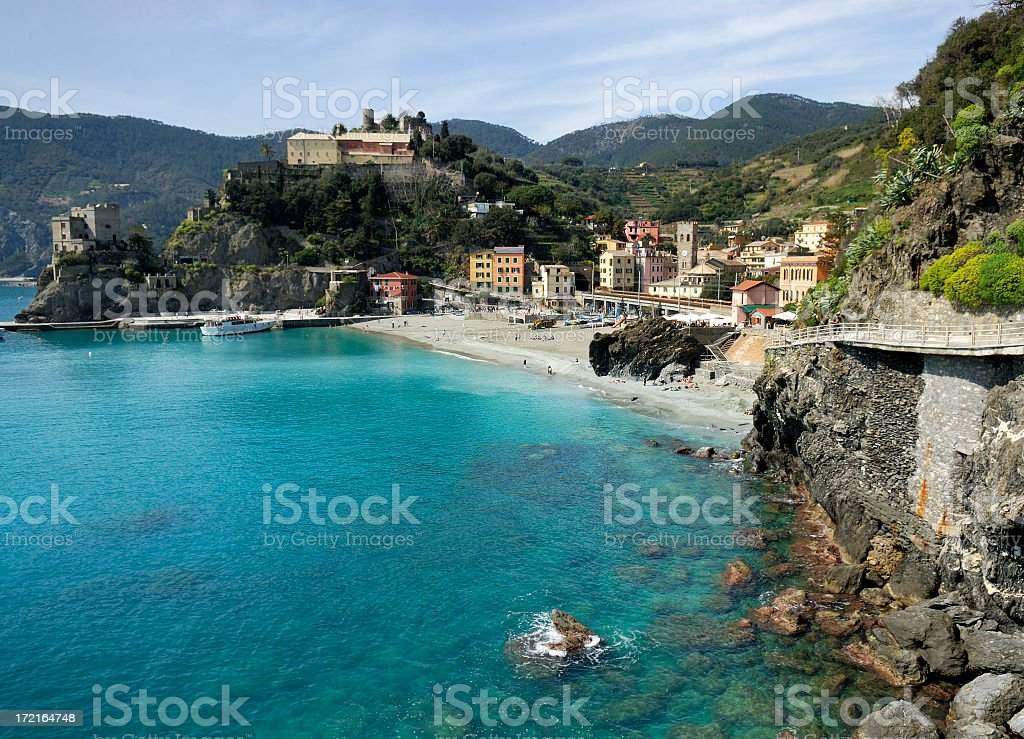 Rocky cliffs and buildings along Monterosso Al Mare, Italy stock photo