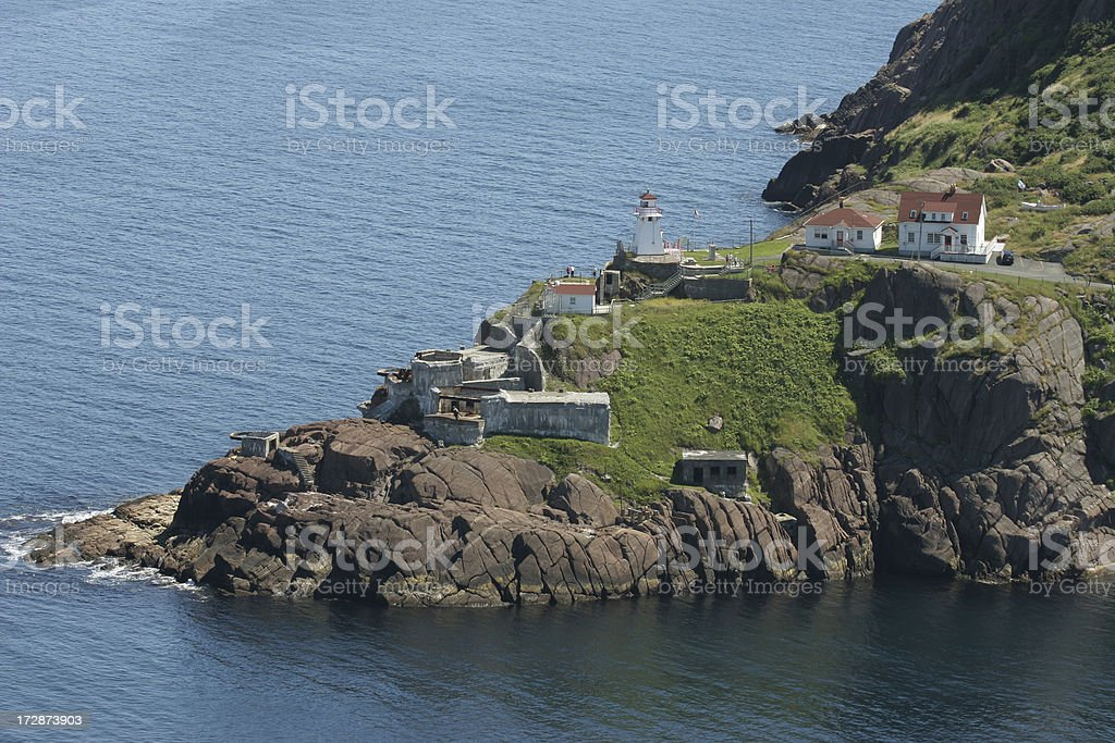 Rocky cliffs and Fort Amherst Lighthouse, St. John's NFLD stock photo