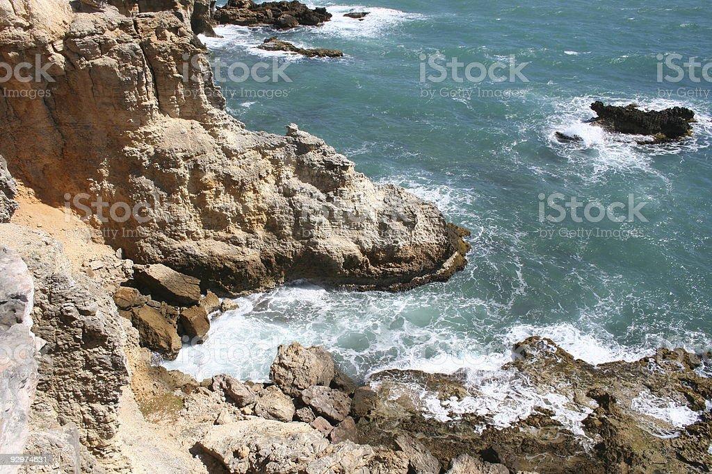 Rocky cliffs, aqua water. royalty-free stock photo