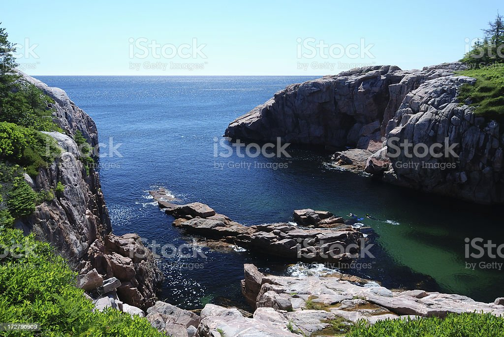 Rocky cliffs on the sea stock photo