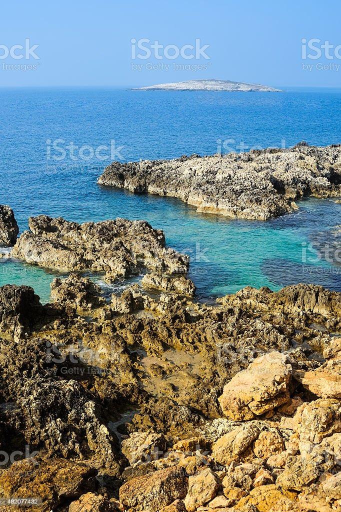 Rocky coast in Istria with a small island stock photo