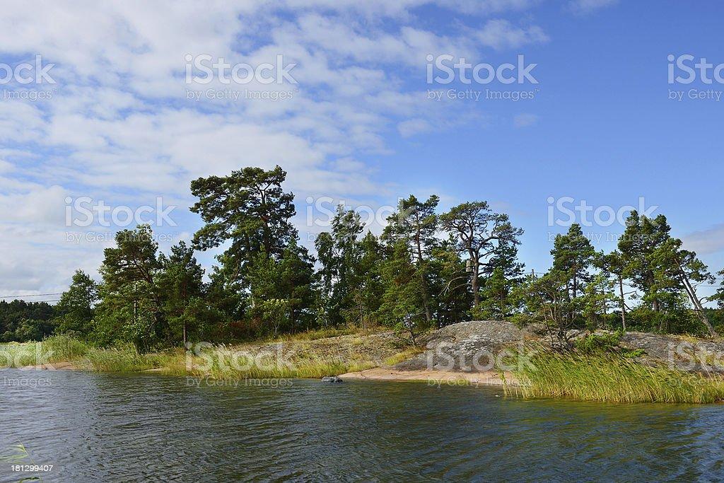 Rocky coast of the island stock photo