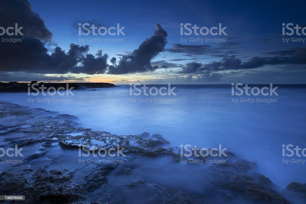 Rocky coast on the island of Curaçao at dusk royalty-free stock photo