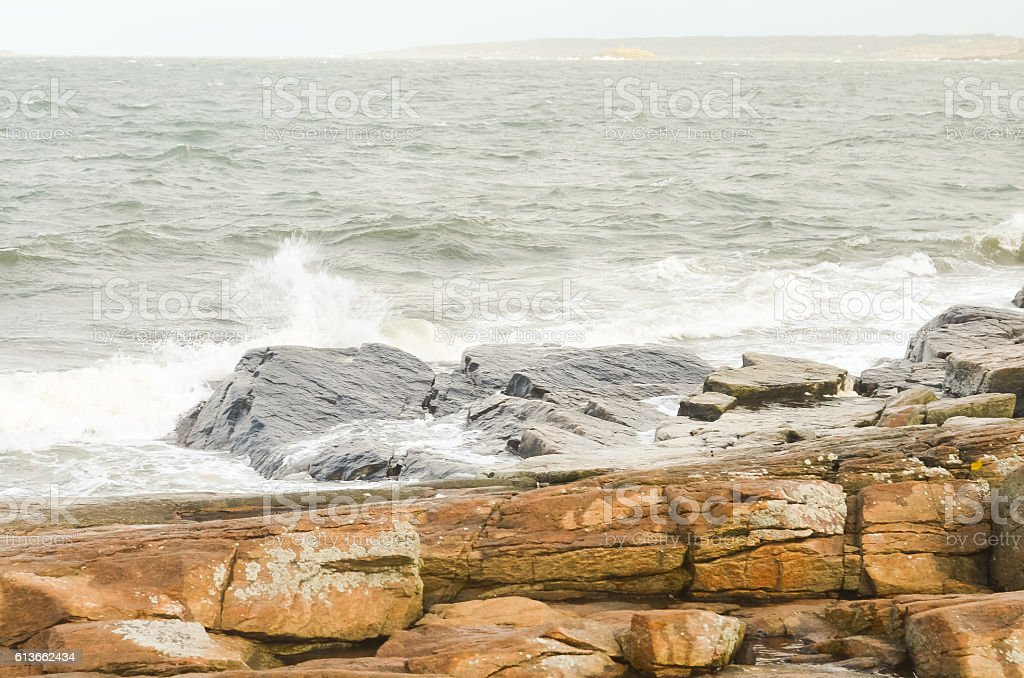 rocky coast with stormy waves in sweden stock photo