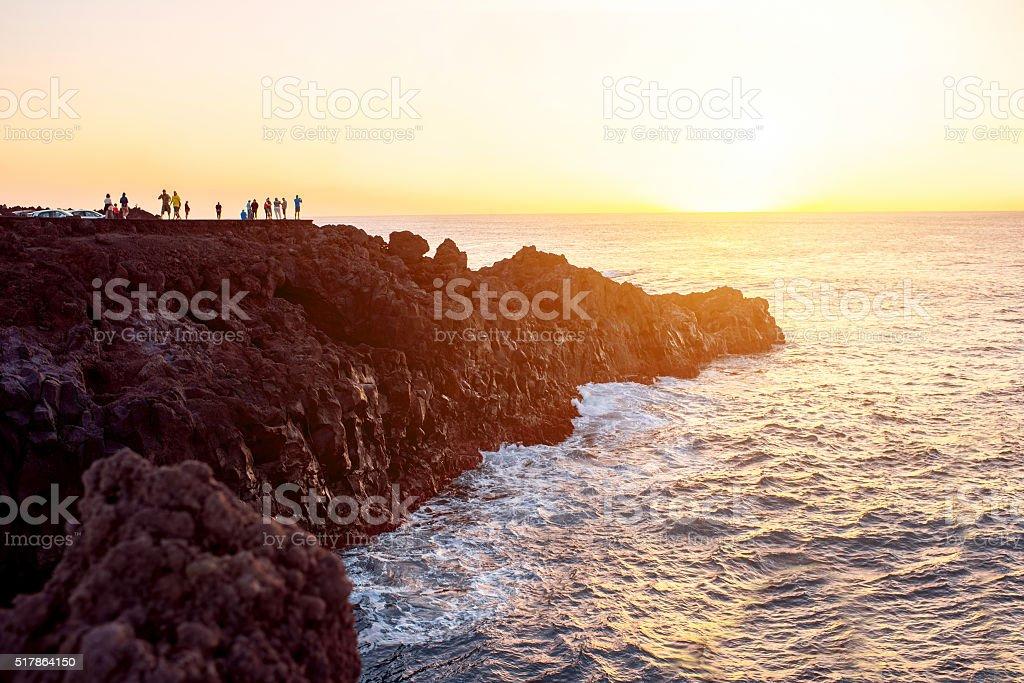 Rocky coast with wavy ocean on Lanzarote island stock photo