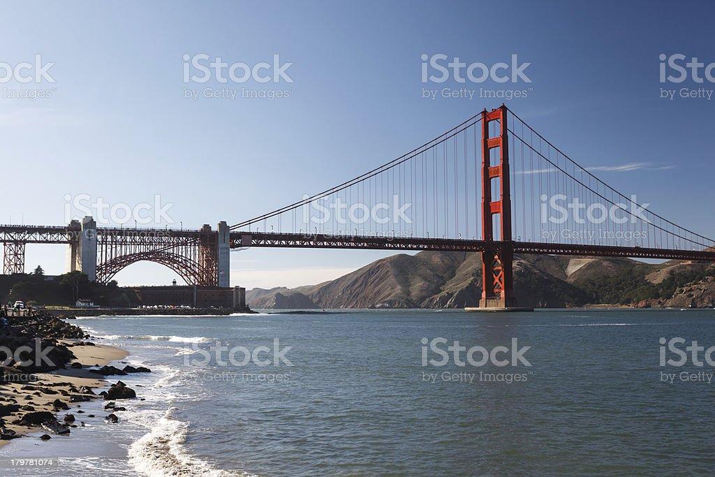 rocky coastline across the Bay and Golden Gate Bridge California royalty-free stock photo