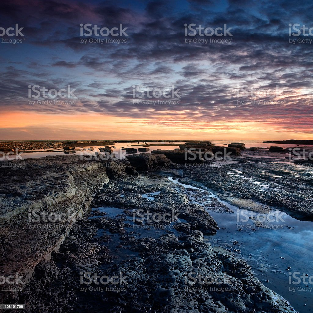 Rocky Coastline Exposed by Low Tide at Sunset royalty-free stock photo