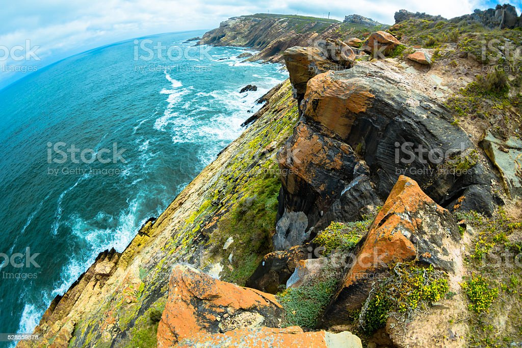 Rocky Coastline in Mossel Bay stock photo