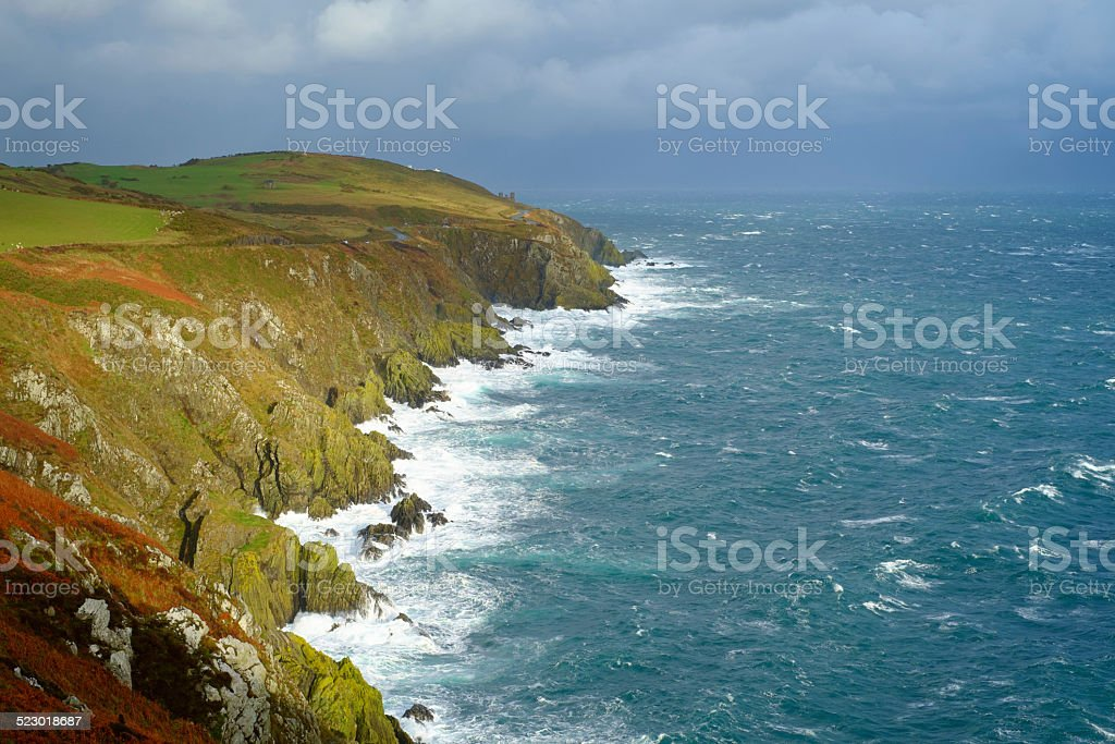Rocky coastline of Isle of Man on windy autumn day stock photo