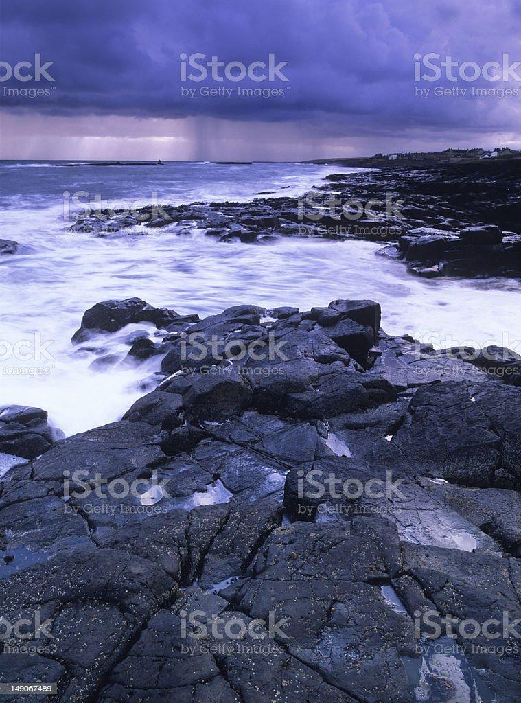 Rocky coastline under approaching storm royalty-free stock photo