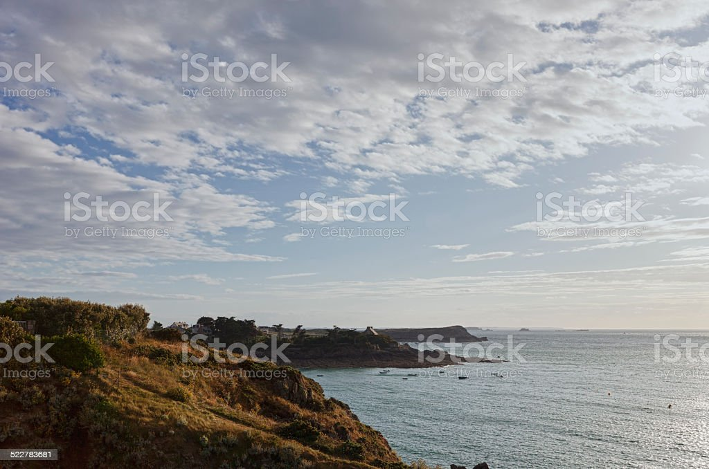 Rocky coastline with cottage in Brittany stock photo