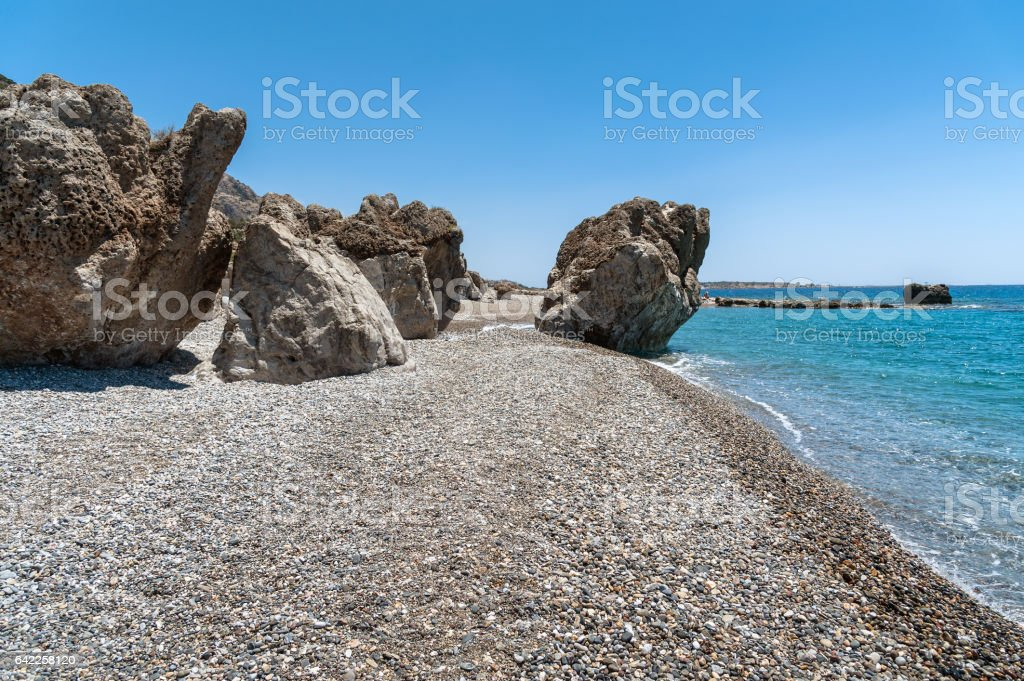 Rocky coastline with turquoise lagoon on Crete island stock photo