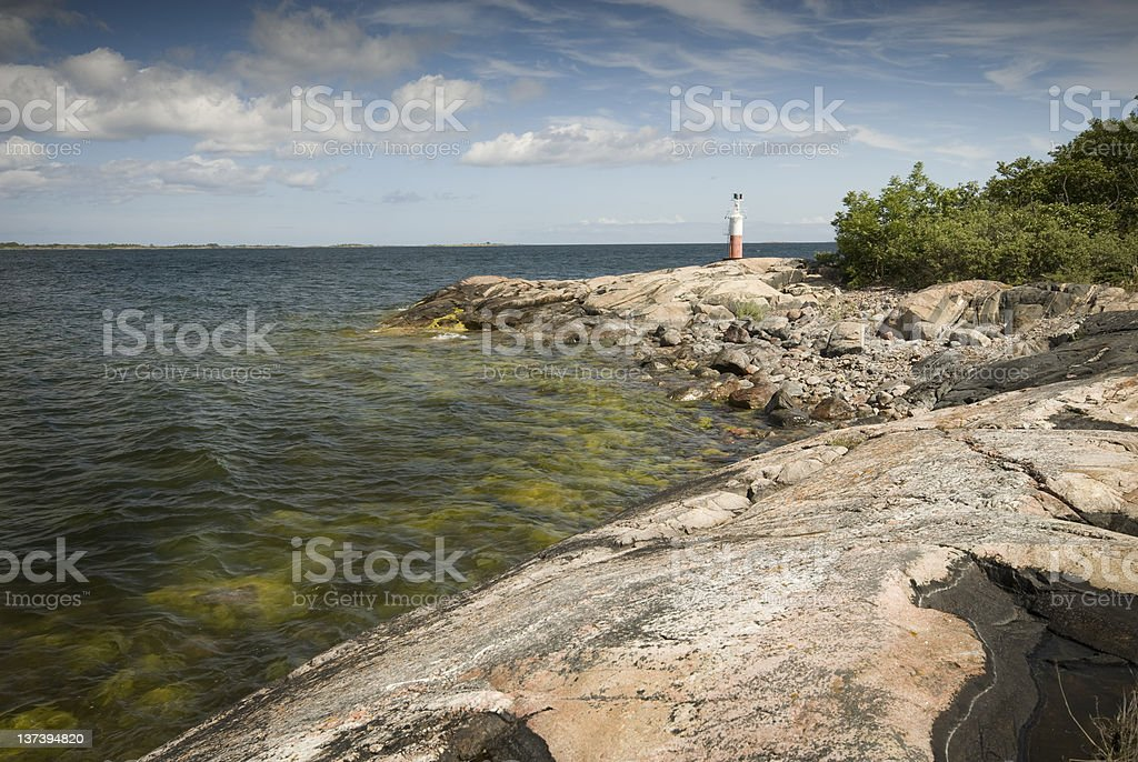 Rocky cost with a lighthouse royalty-free stock photo