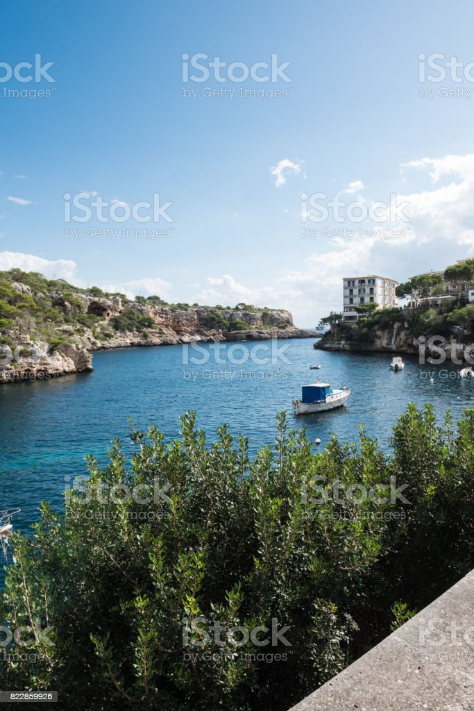 Rocky cove on Mallorca with ships in the sun stock photo