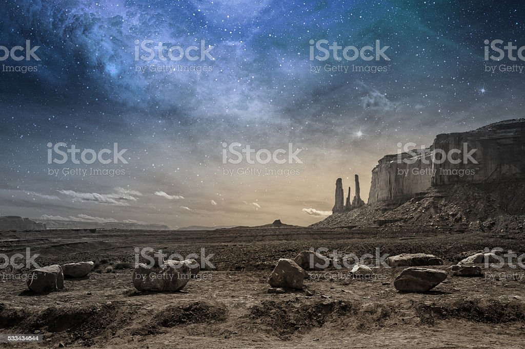 rocky desert landscape at dusk stock photo