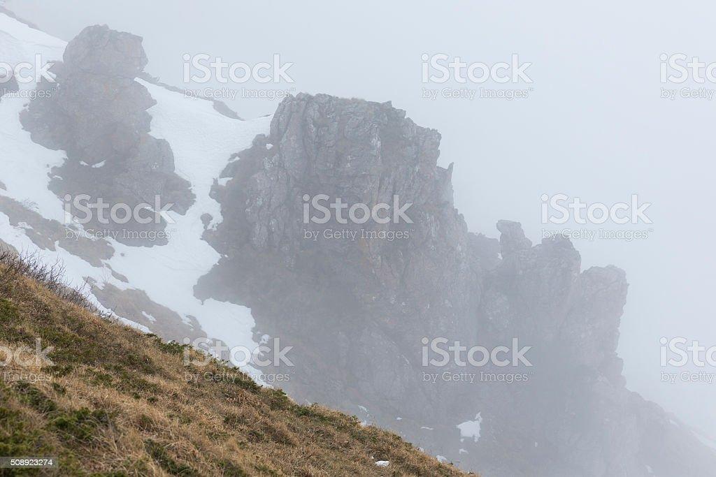 Rocky foggy mountain rocks stock photo