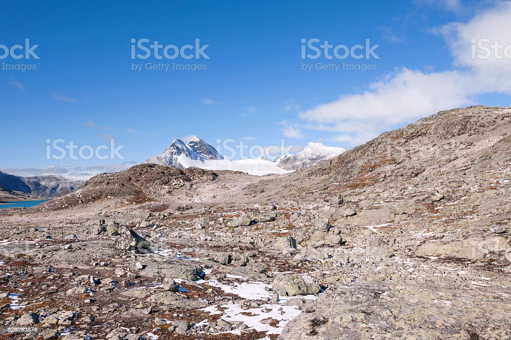 Rocky hiking trail in Jotunheimen National Park after first snow stock photo